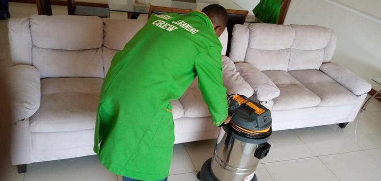 Dust vacuuming off fabric sofa